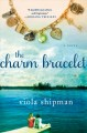 The charm bracelet : [a novel]