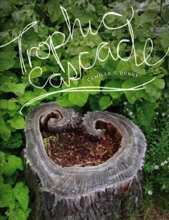 A heart-shaped stump with a crumbling center. It is surrounded by growing green leaves. The title is written in white letters, as if by hand across the image.