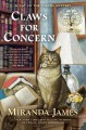 Claws for concern : a cat in the stacks mystery