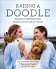 Raising a doodle : heartwarming stories from dog parents around the world