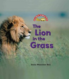 The lion in the grass cover image