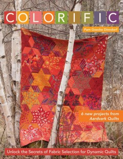 Colorific : unlock the secrets of fabric selection for dynamic quilts cover image