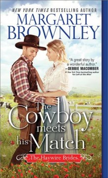 The cowboy meets his match / Margaret Brownley.