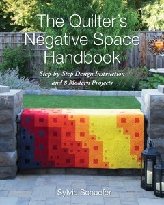 The quilter's negative space handbook : step-by-step design instruction and 8 modern projects / Sylvia Schaefer.