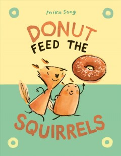 Donut feed the squirrels by Mika Song.