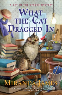 What the cat dragged in / Miranda James.