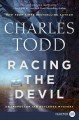 Cover for Racing the devil: an inspector ian rutledge mystery [Large Print]