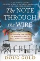 Cover for The Note Through the Wire: The Incredible True Story of a Prisoner of War a...