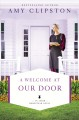 Cover for A welcome at our door