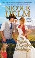 Cover for The trouble with cowboy weddings