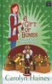 Cover for A gift of bones: a s\arah booth delaney mystery [Large Print]