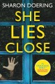 Cover for She lies close