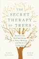 Cover for The secret therapy of trees / Harness the Healing Energy of Forest Bathing ...