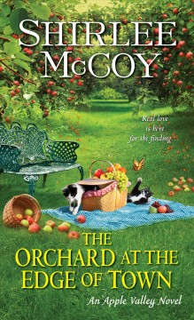 The orchard at the edge of town - Shirlee McCoy